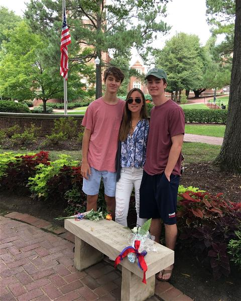 """""""The University of Richmond will always hold a special place in the hearts of the Finnegan family,"""" said Erin Finnegan, whose husband Michael, R'86, was killed in the Sept. 11, 2001 attacks. Their children, Bridget, '18, and Bradley, '21, felt """"a closeness to their father and his legacy,"""" during their time at Richmond, and the four benches on campus dedicated to alumni lost on 9/11 offered a place of peace and comfort for them."""